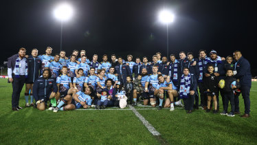 The Waratahs pose for a group shot after completing their winless season.