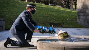 Chief Commissioner Shane Patton laying a wreath at the Victoria Police memorial on last year's Police Remembrance Day.