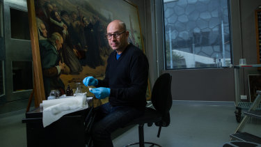 NGV's head of conservation Michael Varcoe-Cocks working on the painting The Pilgrim Fathers.