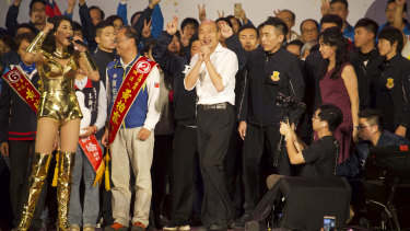 Han Kuo-yu, centre, Taiwan's 2020 presidential election candidate of the KMT or Nationalist Party, at  a campaign rally on Friday.