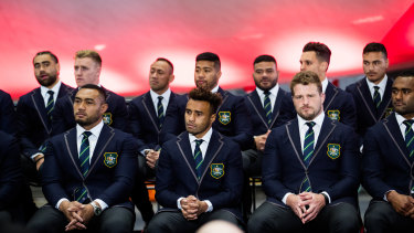 You're in: Petaia (back right) sits with Wallabies teammates at Friday's World Cup squad announcement at Sydney Airport.