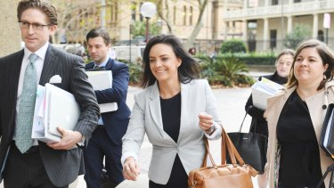 Ms Husar and her legal team arrive for mediation with BuzzFeed last month.
