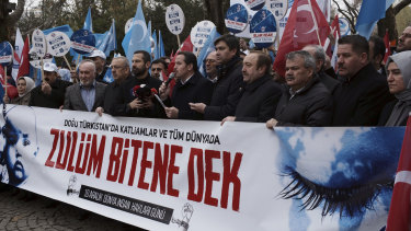 Turkish demonstrators in Ankara stage a protest demanding an end to mass detentions of Uighurs and other predominantly Muslim ethnic minorities in China.