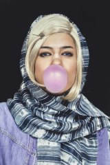 Shirin Aliabadi, the bandaged nose denotes plastic surgery, a status symbol among women in Iran.