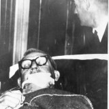 His facial injuries covered by a bandage, Calwell is wheeled on a stretcher into Sydney's Royal North Shore hospital after he was shot on the night of June 21, 1966.