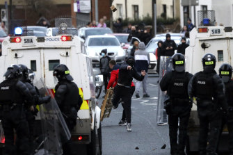 Nationalists from the mainly Catholic Springfield road area of West Belfast clash with police in Northern Ireland on Wednesday.