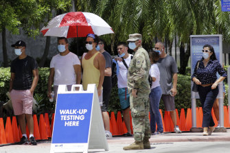 People line up at a COVID-19 testing site in Miami Beach, Florida, this week.