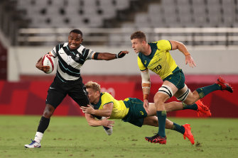 Waisea Nacuqu of Fiji is tackled by Australia's Lachie Miller and Nick Malouf.