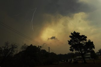 Lightning breaks through while bushfires rage nearby.