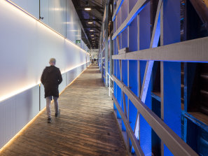 The renovated Walsh Bay wharf housing the Sydney Theatre Company retained the walkway running the length of the building and the harbourside bar.
