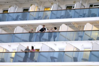 Passengers onboard the Caribbean Princess in Florida, in the United States, in March.