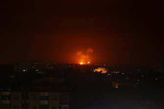 An explosion caused by Israeli air strikes in Gaza City early on Monday.