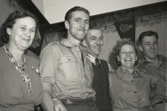 Private J. Burt of Croydon (second from left) is reunited with his family on October 24, 1944.