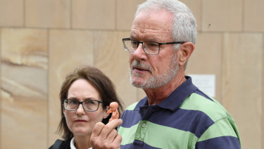 Anti-abortion protesters John Graham Preston and Kathleen Clubb outside the High Court in Brisbane on Wednesday.