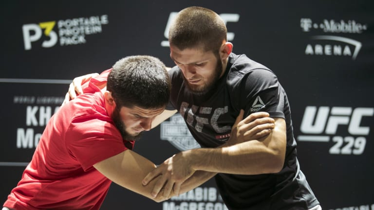Training: Nurmagomedov (right) will want to turn the fight into a wrestle.