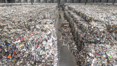 The recycling industry has been in crisis. A Derrimut warehouse where thousands of tonnes of waste has been left by SKM. Its owners want someone to help them remove it.