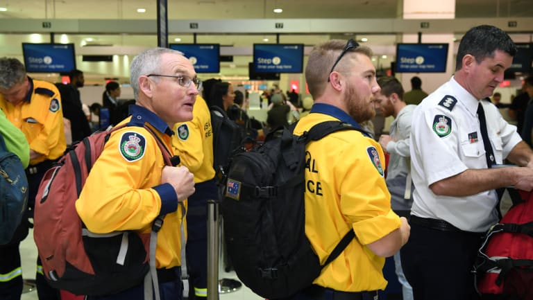 Australian fire specialists prepare to board a fight to California on Friday.