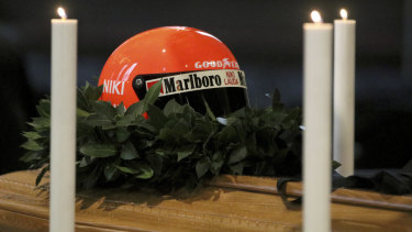 Farewell: Niki Lauda's racing helmet placed atop his coffin.