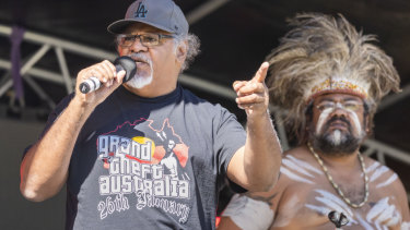 Senior spokesperson and cultural leader of the Wangan and Jagalingou Family Council Adrian Burragubba is seen on stage speaking at a NAIDOC event in South Brisbane on Friday.