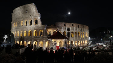 Pope Francis presides over the Via Crucis (Way of the Cross) torchlight procession on Good Friday, a Christian holiday commemorating the crucifixion of Jesus Christ and his death at Calvary, in front of Rome's Colosseum, in Rome.