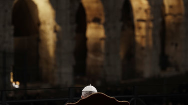 The pope in front of Rome's Colosseum.