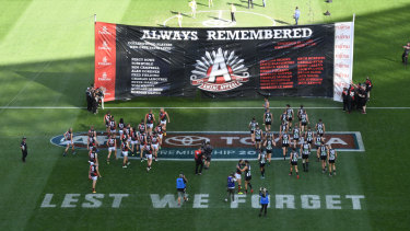 Players from both sides take part in an ANZAC Day ceremony last season.