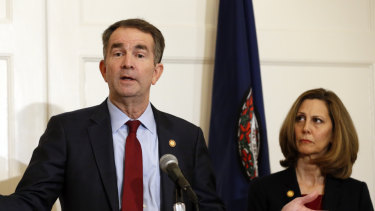 Virginia Governor Ralph Northam,  accompanied by his wife, Pam, speaks during a news conference in the Governor's Mansion in Richmond on Saturday.