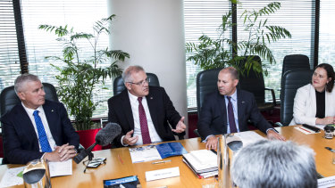 Deputy Prime Minister Michael McCormack, Prime Minister Scott Morrison and Treasurer Josh Frydenberg during a cabinet meeting at the Parliamentary Offices in Brisbane.