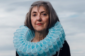 Sydney-based artist and designer Ruth Downes wearing a collar of masks that she made to illustrate the impact on the environment of single use items. She is a finalist for the Northern Beaches' inaugural Environmental Art and Design Prize.  Winners will be announced after the current lockdown.