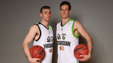 Melbourne United's Mitch McCarron (left) and South East Melbourne Phoenix's Ben Madgen at Thursday's launch of the new NBL season.