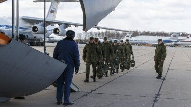 Russian military medical staff prepare to board a cargo plane that sent medical personnel and supplies to Italy last month.