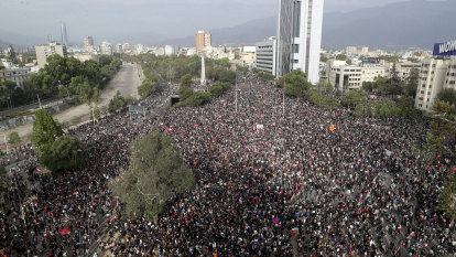As protests resume in Chile economy slows