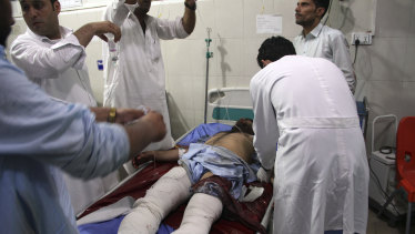 A wounded man receives treatment at a hospital after a suicide car bomb  in Jalalabad, east of Kabul, in August.