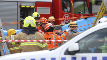 Emergency service workers at the scene of the tragedy.
