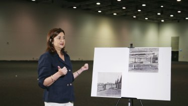 Premier Annastacia Palaszczuk  in one of the Royal International Convention centre's spaces which could be converted into makeshift hospitals, next to images of the RNA being used as a field hospital during the 1919 Spanish flu epidemic in Brisbane.