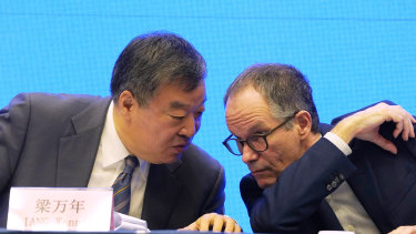 Peter Ben Embarek, of the World Health Organization team, right, chats with his Chinese counterpart Liang Wannian during a WHO-China Joint Study Press Conference held at the end of the WHO mission in Wuhan on Tuesday.