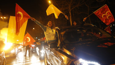 Supporters of President Recep Tayyip Erdogan celebrate in Istanbul, early on Monday, April 1.