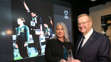 Recognition, at last: Australian Olympic Committee president John Coates and Janita Norman during a ceremony for late Olympian Peter Norman in June.