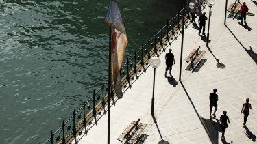 Circular Quay is normally filled with tourists, but social distancing measures are keeping people away.