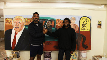 Adam Goodes and Vincent Namatjira when Goodes visited Indulkana in 2018.
