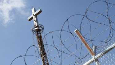 A steel cross rises above the border fence at the Demilitarised Zone seperating North and South Korea.