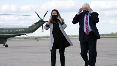 Vice-President Mike Pence and his wife Karen prepare to address the media as they leave Washington for Utah, where the vice-presidential debate will take place.