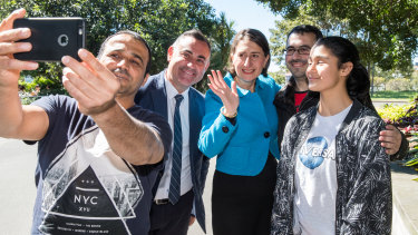 Premier Gladys Berejiklian and Deputy Premier John Barilaro with members of the public on Sunday after announcing the new ministry.