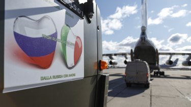 Military trucks load onto an Il-76 cargo plane at Chkalovsky military airport outside Moscow, Russia.