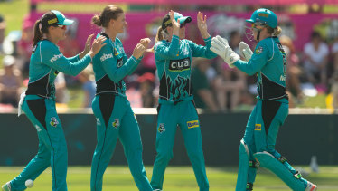Firing: The Brisbane Heat produced a brilliant piece of fielding to win their semi-final, then followed it up by defeating the Sixers in the final on Saturday.