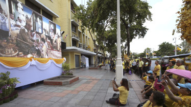 Thai people watch the ceremony on television.