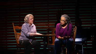 No-nonsense schoolteacher Beulah (Emma Powell) counsels visitor Hannah (Sharriese Hamilton), who fears for her son, a New York firefighter.