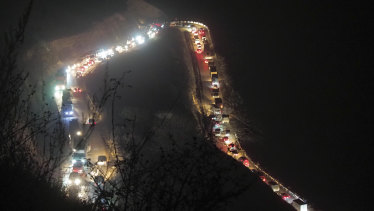 Cars and trucks stuck in a huge traffic jam climbing along the road from Kalbajar to a mountain pass leaving the separatist region of Nagorno-Karabakh to Armenia.