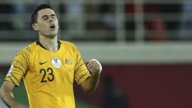 Absentee: Tom Rogic, in action against Uzbekistan, will miss Australia's quarter-final.