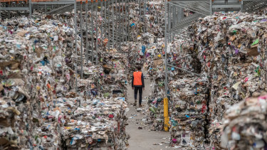 A warehouse stacked to the rafters with bales of recycling waste.